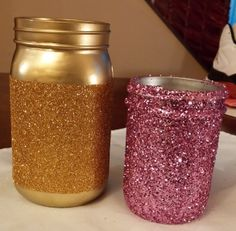 Freshly painted Mason Jars, add some modge podge and glitter :)