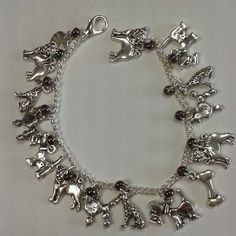 Charm Bracelet - Dogs. £9.99 plus p&p. Available with your choice of coloured glass seed beads.