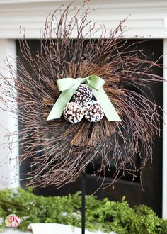 Grab your glue gun and some pinecones to make this one-of-a-kind seasonal wreath. || @splendidamy