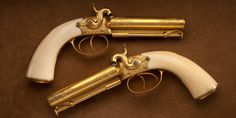 Pape Double Barrel Pistols – This cased pair of W.R. Pape gold and ivory percussion pistols is housed in the Robert E. Petersen Gallery at the NRA National Firearms Museum.  Mr. Pape was well known in the Victorian arms trade, first for becoming a gunmaker at age 27 without serving a formal apprenticeship and also for relying on other makers to create his components, based on Pape's own patents.  But for fit and finish, Pape's products were legendary.