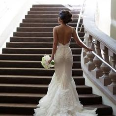 The bride wore a gorgeous low back trumpet gown with a fishtail skirt.