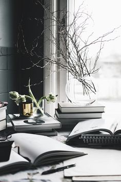 Winter styling in grey and white with dark paint on walls.