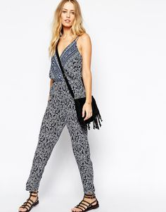 """Jumpsuit by Pepe Jeans Lightweight, smooth woven fabric Part lined Plunge neckline Wrap bodice Double slim shoulder straps Elastic to waist Regular fit - true to size Machine wash 100% Polyester Our model wears a UK 8/EU 36/US 4 and is 175 cm/5'9"""" tall"""