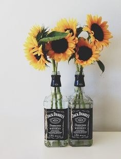 """I wanna do this for centerpieces! Except a different bottle at each table and instead of numbers each card for seating will be labeled """"jack"""" """"Johnny"""" """"kraken"""" """"jerry"""" and so on :) #wedding #sunflowers"""