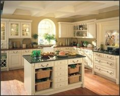 Country Kitchen Decorating Ideas. Love the Island with the baskets, add red walls and it would be perfect!