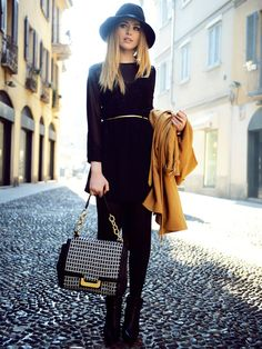 """A three quarter sleeve black dress, black tights, black hat and a gold & black bag that ties this together quite fashionably. Makes wearing """"all black"""" feel more than monochromatic."""