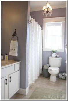 beautiful bathroom. Love the trim around the window.