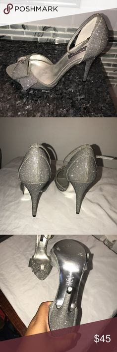 Nina silver heels - ankle strap , peep toe NEW WITH TAGS --- **GLAMOUR** These super cute peep toe heels are great for weddings, date night, and special events!! The adjustable ankle strap and toe charm add flair. These 4 inch heels are FABULOUS Nina Shoes Heels