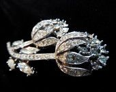 Vintage Crown Trifari Brooch in floral design, two budding flowers covered in clear rhinestones. Great for that added touch of style.