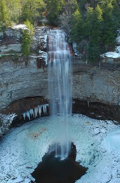 Fall Creek Falls, Tennessee.  Fall Creek Falls is one impressive waterfall.  It's 256 feet tall,  so the icicles you see hanging down are as big around as telephone  poles and 30 feet long.