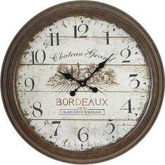 Showcasing a distressed finish with a French country accent and text detailing, this rustic wall clock adds antique-inspired appeal to your living room or be...
