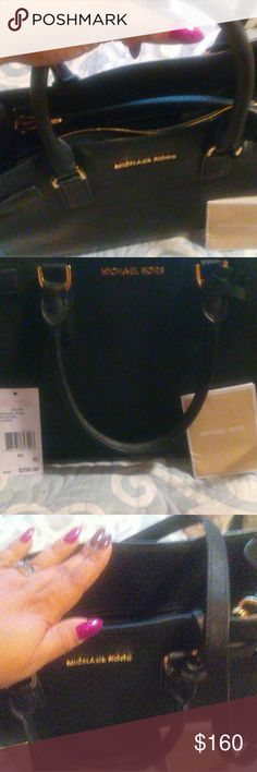 Black MK dillon Ew satchel In Great used condition, Leather satchel. Had it for over a year but have tried my best to take care of it. Got is for 279$ with tax it was on sale, but as you can see i kept the tag. This is a sweet deal. I f i don't get close to my asking price I will just keep it. Bundle and save!! Happy poshing!! Michael Kors Bags Satchels