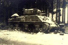 This M-4 A-3 Sherman tank of the 6th Armored Division was knocked out by a German 75mm anti tank gun on 3 January, 1945. The tank was pushing along a road parallel to the railroad line NE of Bastogne, toward the hamlet of Bourcy, Belgium.