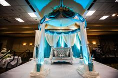 Amazing bride and groom seating for an Indian Wedding