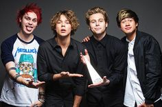 5 Seconds of Summer band (From Left)- Michael Clifford, Ashton Irwin, Luke Hemmings, and Calum Hood...