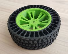 Designed these to use with my Traxxas E-Revo VXL Its a dual extrusion print. I used PLA (green) and Flex (black). These tires drift more than th Impression 3d, Diy 3d Drucker, E Revo, 3d Printer Designs, 3d Prints, Wheels And Tires, Rc Cars, 3d Design, Arduino