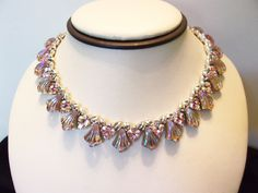 A personal favorite from my Etsy shop https://www.etsy.com/listing/207751726/coro-jewelry-necklace-pink-glass