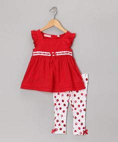 As adorable as it is easy to coordinate, this delightful duo will have girls looking and feeling their absolute best. Simply slip on the tunic, slide on the stretchy bottoms and start that day! Each piece is great for mixing and matching, too.Includes tunic and leggingsTunic: 100% cottonLeggings: 54% cotton / 40% polyes...