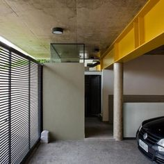 Concrete Cube Home Supported on 2 Yellow I Beams