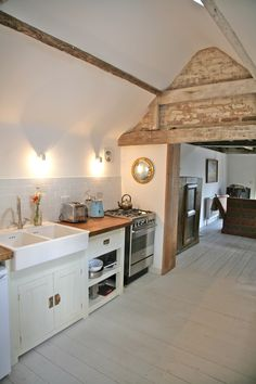 The Piggery, Hawthbush Organic Farm, East Sussex. The kitchen is well equipped with a Belfast sink and a Smeg cooker