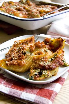 Spinach and Riccotta Stuffed Pasta Shells Don't worry about converting the cheese amounts- this is similar to other recipes and it looks good.