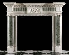 Antique neoclassical style breakfront statuary and verde antico marble chimneypiece. Irish circa 1850.