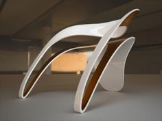 This is a beautiful and stylish chair designed by Luca Veneri, a London based designer.ZIG-ZAGA chair series use the Lamiflex® or multistrate Corian® as material