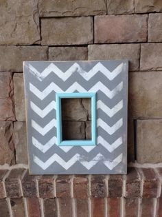 Handmade and handpainted, this oversized wooden frame is perfect for a favorite photo.  Opening size is 5x7  Frame measures 17x15x1  Love the