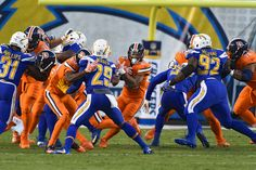 Broncos vs. Chargers:   October 13, 2016  -  21-13, Chargers   -       Denver Broncos running back Devontae Booker (23) finds a hole in the San Diego Chargers defense for a short gain during the second quarter October 13, 2016 at Qualcomm Stadium in San Diego, Calif.