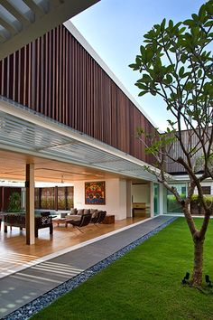 Enclosed Open House by Wallflower Architecture + Design: Stylish living room design idea in a spacious contemporary house in Singapore