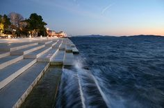 The Sea organ is an architectural object located in Zadar, Croatia and an experimental musical instrument which plays music by way of sea waves and tubes located underneath a set of large marble steps.The waves create somewhat random but harmonic sounds. The device was made by the architect Nikola Bašić. In 2006, the Sea Organ was awarded with the prize ex-aequo of the fourth edition of the European Prize for Urban Public Space.