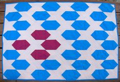 Create a beautiful gift for a special little someone with this Sapphires and Rubies Baby Quilt. This colorful baby quilt uses easy block patterns for an eye-catching but simple design that's perfect for a nursery. It's also a useful handmade baby qui Scrap Quilt Patterns, Crochet Blanket Patterns, Block Patterns, Crochet Blankets, Baby Blankets, Cute Quilts, Easy Quilts, Quilting Tutorials, Quilting Designs