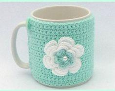 Crochet mug cozy mint green. - Mint green and white crochet mug cozy by MyfanwysMakes on Etsy, - Crochet Coffee Cozy, Crochet Cozy, Love Crochet, Crochet Gifts, Mint Green Flowers, Crochet Home Decor, Crochet Kitchen, Yarn Crafts, Crochet Projects
