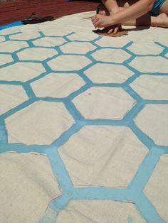 DIY painted canvas drop cloth rug for the patio. Less than ten bucks!