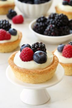 Berry Cookie Cups combine sweet sugar cookies and white chocolate cream cheese filling to create the perfect summer dessert!  Recipe contains gluten-free option.