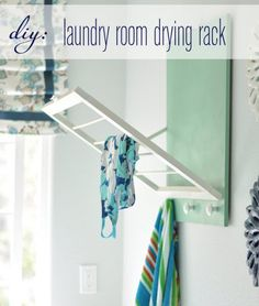 How-To: Fold-Out Laundry Room Drying Rack Living in NYC where space is definitely at a premium, I can't resist a good space-saving home solution. That's why I'm such a fan of this awesome DIY fold-out laundry room drying rack! Laundry Room Drying Rack, Laundry Room Organization, Laundry Rack, Organization Hacks, Laundry Rooms, Drying Racks, Laundry Tips, Organizing Ideas, Laundry Basket