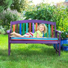 Paint a plain garden bench in your favorite colors, then sew a beach towel around a cushion to create a comfy seat.