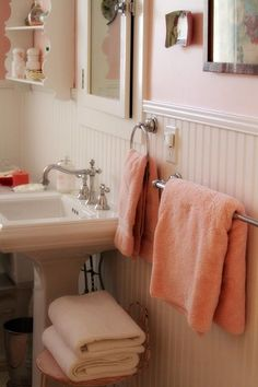 Pink bathroom, white wainscoting, pedestal sink