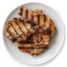 Put the garlic, soy sauce, sugar and oil in a mini food processor and process until the garlic is pureed. Put the pork chops on a rimmed baking sheet and pour the marinade over them; turn to coat the chops. Let stand at room temperature for 15 to 30 minutes.