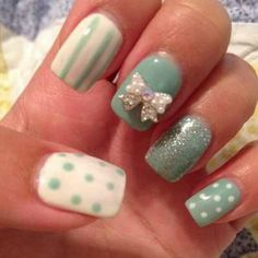 Cute white 3D bow on teal nails.