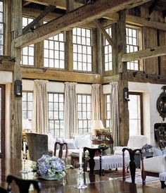 Dining beneath the exposed bents, brackets and beams of a converted barn stimulates the appetites of guests full of conversation, laughter, and storytelling. | Photo: John Gruen | thisoldhouse.com