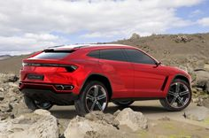 Lamborghini Urus SUV leaks... Teased earlier today in a bizarre elemental video, the leaked press shots from AutoForum.cz show an angular, aggressive car with a crouching stance and an interior that's never, ever going to make it to the showroom. It's a four-seater, like Range Rover's Evoque, and we imagine rear headroom is going to be just as low as in the rival fashion-4×4. Under the hood is expected to be a 5.2-liter V10 engine, capable of around 584 hp.