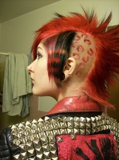 Girls short red mohawk with stripes and cheetah print