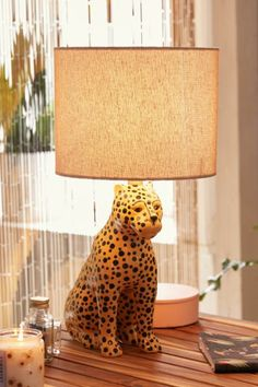 Obsessed with this Leopard Table Lamp from Urban Outfitters. It brings such a cool vibe to home decor. Imagine it in a workspace as office lighting or sitting super cool in the corner of your living room lighting the space. Stained Glass Table Lamps, Glass Lamps, Bedroom Lamps, Bedroom Ideas, Unique Lamps, Home And Deco, Home Lighting, Office Lighting, Desk Lamp
