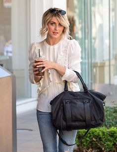 | julianne hough carrying our #sheandlo #nextchapter satchel in black perf |
