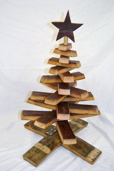 Our smaller version of the wine barrel stave Christmas tree. These trees take up very little space, set up in seconds, and best of all no clean up