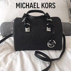 """✨NEW MICHAEL KORS BLACK GRAYSON SATCHEL✨ Beautiful NEW WITH TAGS MICHAEL KORS black coated canvas Grayson satchel. Has the MK pattern throughout. Silver hardware. Leather handles and shoulder strap. Has silver feet on bottom of purse. Zippers closed. Has four cell phone open pouches and one zipper pouch inside. Purse measures just over 11"""" inches wide, 8.5 """" inches height, and 7"""" inches depth. Removable strap measures currently 46"""" inches and can be made slightly shorter or longer. STUNNING…"""