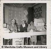 - Photograph is part of a series taken of a Canadian Handicrafts Guild - Manitoba Branch display at the Carman Fair, possibly in the Photograph of three women, possibly CHG - MB members. Craft Museum, Handicraft, 1950s, Photograph, Canada, Display, Crafts, Painting, Women