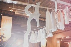 garlands with glitter letters and metallic tassels // photo by StudioCastillero.com