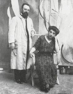 Matisse and Madame Matisse in the studio of Issy-les-Moulineaux in front of the unfinished Bathers by a River, May, 1913.